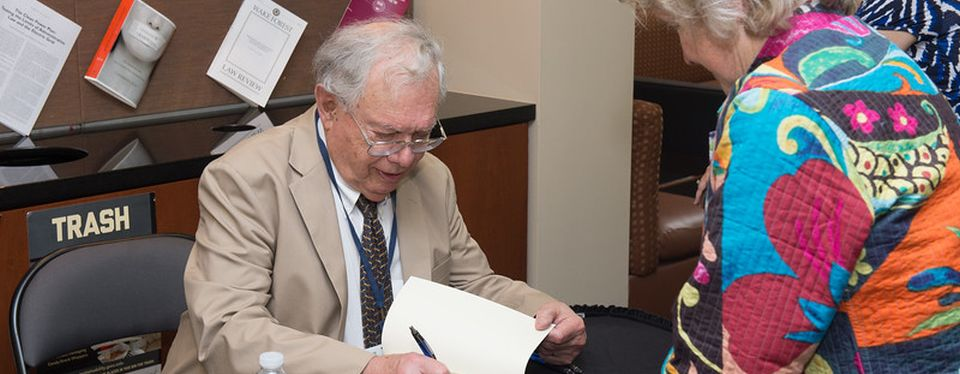 GW Law alumni eagerly awaited Dean Barron's book signing during Reunion Weekend 2016.