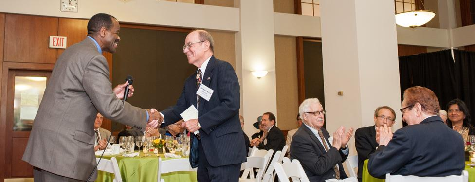 Dean Blake Morant welcomes Stockton Guard Convenor The Hon. Bruce Mencher​ to the podium during Alumni Weekend 2014